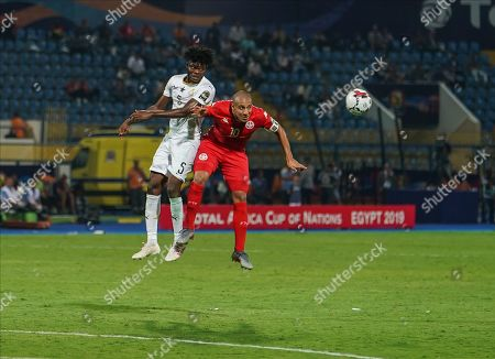 FRANCE OUT Thomas Teye Partey of Ghana and Wahbi Khazri of Tunisia challenging for the ball during the African Cup of Nations match between Ghana and Tunisia at the Ismailia Stadium in Ismailia, Egypt
