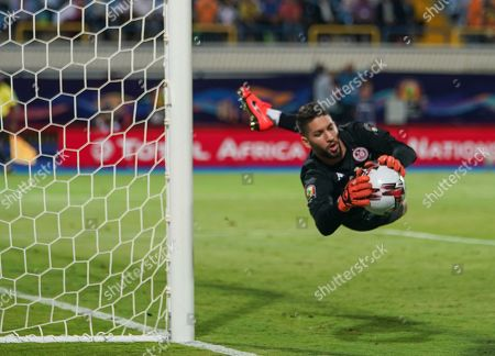 Stock Photo of FRANCE OUT Hassen Mouez of Tunisia saving a shot during the African Cup of Nations match between Ghana and Tunisia at the Ismailia Stadium in Ismailia, Egypt