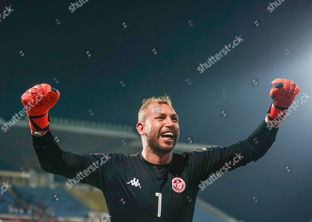 Stock Photo of FRANCE OUT Farouk Ben Mustapha of Tunisia celebrating the victory during the African Cup of Nations match between Ghana and Tunisia at the Ismailia Stadium in Ismailia, Egypt
