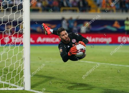 Stock Image of FRANCE OUT Hassen Mouez of Tunisia saving a shot during the African Cup of Nations match between Ghana and Tunisia at the Ismailia Stadium in Ismailia, Egypt