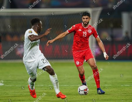 FRANCE OUT Ferjani Sassi of Tunisia and Andrew Kyere-Yiadom of Ghana during the African Cup of Nations match between Ghana and Tunisia at the Ismailia Stadium in Ismailia, Egypt