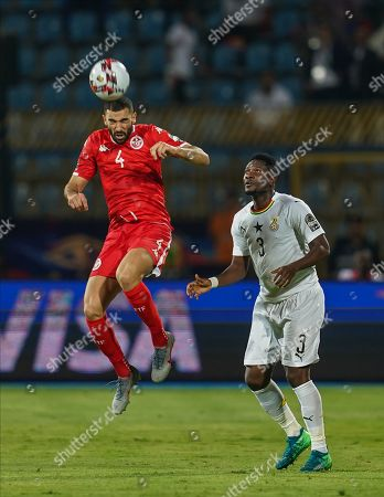 FRANCE OUT Yassine Meriah of Tunisia and Asamoah Gyan of Egypt during the African Cup of Nations match between Ghana and Tunisia at the Ismailia Stadium in Ismailia, Egypt