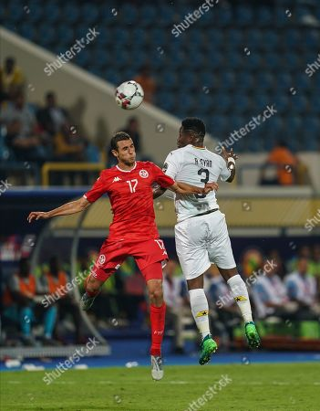 Stock Image of FRANCE OUT Asamoah Gyan of Egypt and Ellyes Joris Skhiri of Tunisia challenging for the ball during the African Cup of Nations match between Ghana and Tunisia at the Ismailia Stadium in Ismailia, Egypt