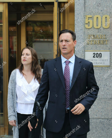 Victim lawyer Brad Edwards, right, leaves with his client Michelle Licata, left, after a hearing at Manhattan Federal Court for wealthy financier Jeffrey Epstein, a convicted sex offender who has been arrested in New York on sex trafficking charges, in New York