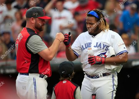 Toronto Blue Jays Vladimir Guerrero Jr. (R) is greeted by Toronto Blue Jays coach John Schneider (L) who pitched to Guerrero during the MLB All-Star T-Mobile Home Run Derby first round at Progressive Field in Cleveland, Ohio, USA, 08 July 2019.
