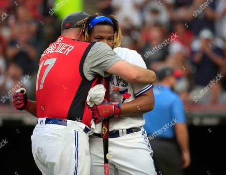 Toronto Blue Jays Vladimir Guerrero Jr. (R) hugs Toronto Blue Jays coach John Schneider (L) who pitched to Guerrero during the MLB All-Star T-Mobile Home Run Derby first round at Progressive Field in Cleveland, Ohio, USA, 08 July 2019.