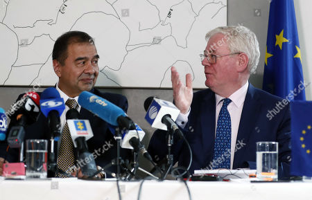 Stock Photo of European Union (EU) Special Envoy for the Peace Process in Colombia Eamon Gilmore (R) speaks next to Colombian interim Attorney General Fabio Espitia (L) during a press conference in Bogota, Colombia, 08 July 2019. The EU announced that it will give 2 million euros to reinforce the special division of prosecution that are investigating the murders of social leaders and former guerrillas.