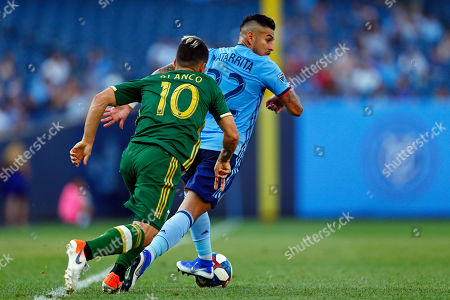 New York City defender Ronald Matarrita (22) controls the ball in front of Portland Timbers midfielder Sebastian Blanco (10) during an MLS soccer match, in New York. The Timbers won 1-0
