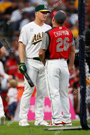 Oakland Athletics Matt Chapman (L) talks with his father Jim Chapman (R), who is pitching to him, during the MLB All-Star T-Mobile Home Run Derby time-out first round at Progressive Field in Cleveland, Ohio, USA, 08 July 2019.