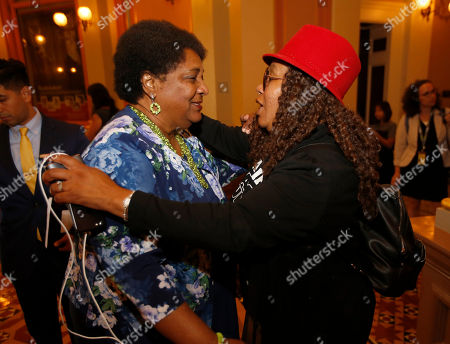 Stock Image of Assemblywoman Shirley Weber, D-San Diego, left, receives congratulations from Beatrice Johnson, the aunt of police shooting victim Oscar Grant, after her police use of force bill was approved by the state Senate in Sacramento, Calif., . Weber's bill, AB392, would bar police from using lethal force unless it is necessary to prevent imminent threat of death or serious injury to themselves or bystanders