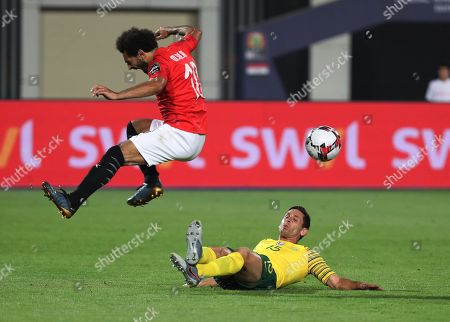 Dean Furman of South Africa tackles Mohamed Salah of Egypt during the 2019 Africa Cup of Nations Finals Last 16 football match between Egypt and South Africa at the Cairo International Stadium, Cairo, Egypt, 06 July 2019.
