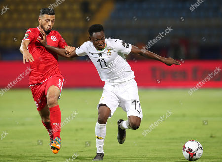 Stock Photo of Abdul Rahman Baba of Ghana challenged by Anice Badri of Tunisia during the 2019 Africa Cup of Nations Last 16 match between Ghana and Tunisia at the Ismailia Stadium, Ismailia, Egypt, 08 July 2019.