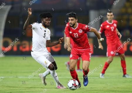Ferjani Sassi of Tunisia challenged by Thomas Teye Partey of Ghana during the 2019 Africa Cup of Nations Last 16 match between Ghana and Tunisia at the Ismailia Stadium, Ismailia, Egypt, 08 July 2019.