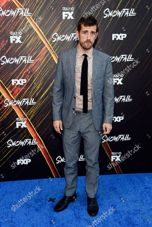 "Carter Hudson, a cast member in the FX series ""Snowfall,"" poses at the third season premiere of the FX show, in Los Angeles"