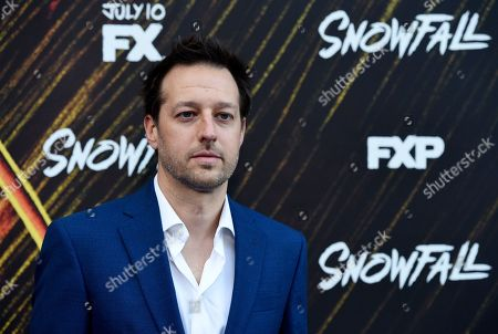 """Dave Andron, co-creator and executive producer of the FX series """"Snowfall,"""" poses at the third season premiere of the FX show, in Los Angeles"""