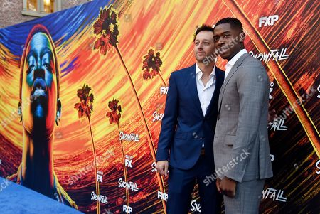 """Damson Idris, Dave Andron. Damson Idris, right, star of the FX television series """"Snowfall,"""" poses with the show's co-creator/executive producer Dave Andron at the third season premiere of the show, in Los Angeles"""