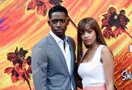 "Damson Idris, Reign Edwards. Damson Idris, left, and Reign Edwards, cast members in the FX television series ""Snowfall,"" pose together at the third season premiere of the show, in Los Angeles"
