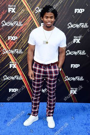 """Isaiah John, a cast member in the FX television series """"Snowfall,"""" poses at the third season premiere of the show, in Los Angeles"""