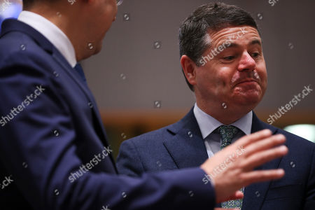 Ladislav Kamenicky, Paschal Donohoe. Ireland's Finance Minister Paschal Donohoe, right, listens to Slovakia's Finance Minister Ladislav Kamenicky during the European Finance Ministers meeting at the European Council headquarters in Brussels