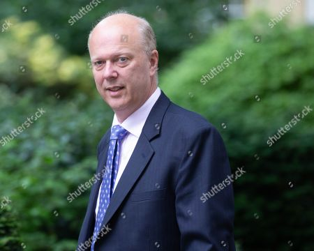 Chris Grayling, Transport Minister, arrives for the weekly Cabinet Meeting.