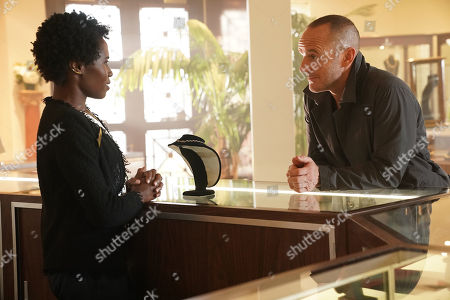 Stock Image of Sola Bamis as Dana and Clark Gregg as Phil Coulson