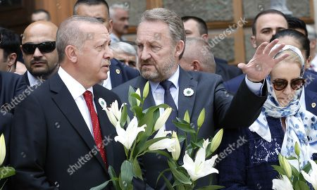 Stock Photo of Turkish President Recep Tayyip Erdogan (L) with President of the Democratic Action Party (SDA) Bakir Izetbegovic (R) during the farewell ceremony in Sarajevo, Bosnia and Herzegovina, 09 July 2019.  Erdogan came to Bosnia to take part in South East European Countries Cooperation Process (SEECP) Summit.