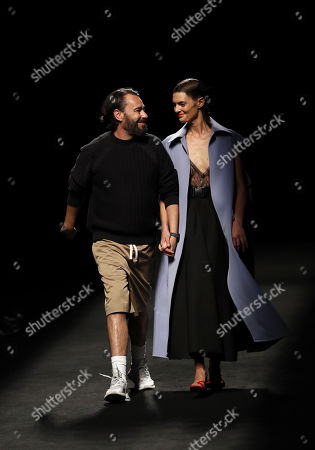 Stock Picture of Spanish designer Juanjo Oliva (L) and model Marina Perez (R) appear on the catwalk after the presentation of his Spring-Summer 2020 collection for his label Oliva during the 70th Mercedes-Benz Fashion Week Madrid, in Madrid, Spain, 09 July 2019. The MBFWM runs from 05 to 10 July.