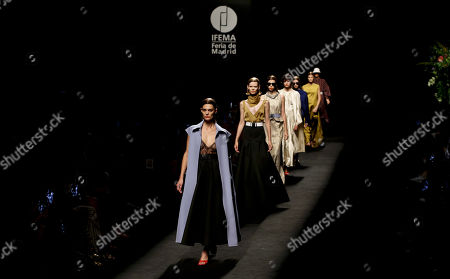 Stock Image of Spanish model Marina Perez (front) and other models present creations from the Spring-Summer 2020 collection by Spanish designer Juanjo Oliva for his label Oliva during the 70th Mercedes-Benz Fashion Week Madrid, in Madrid, Spain, 09 July 2019. The MBFWM runs from 05 to 10 July.