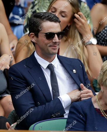 Actor Matthew Goode smiles as he takes his seat in the Royal Box on Centre Court on day eight of the Wimbledon Tennis Championships in London