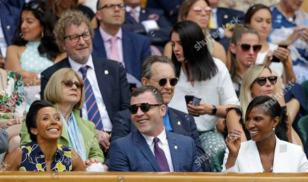 Former Olympic champion athletes Kelly Holmes, left, and Denise Lewis, right, sit in the Royal Box on Centre Court on day eight of the Wimbledon Tennis Championships in London