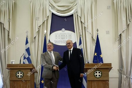 Outgoing Foreign Affairs Minister Georgios Katrougalos (L) shakes hands with the newly appointed Foreign Minister Nikow Dendias (R) during the handover ceremony at the ministry in Athens, Greece, 09 July 2019. New cabinet with 51-members were sworn in on 09 July at the Presidential palace in Athens.