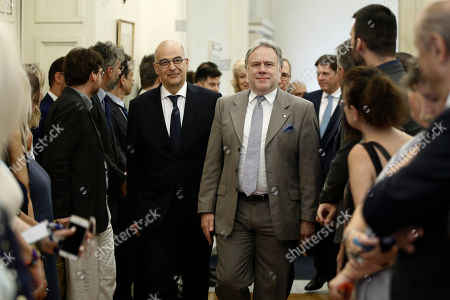 Stock Photo of Outgoing Foreign Affairs Minister Georgios Katrougalos (C-R) walks next to the newly appointed Foreign Minister Nikow Dendias (C-L) during the handover ceremony at the ministry in Athens, Greece, 09 July 2019. New cabinet with 51-members were sworn in on 09 July at the Presidential palace in Athens.