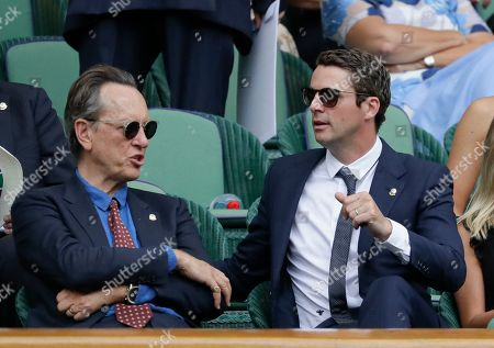 Actors Richard E. Grant, left, and Matthew Goode speak while sitting in the Royal Box on Centre Court on day eight of the Wimbledon Tennis Championships in London