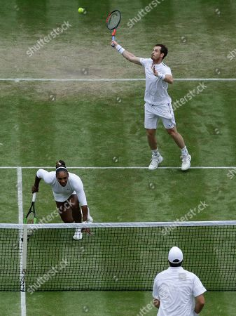 United States' Serena Williams and playing partner Britain's Andy Murray, top, in action against Fabrice Martin of France and Raquel Atawo of the United States in a mixed doubles match on day eight of the Wimbledon Tennis Championships in London