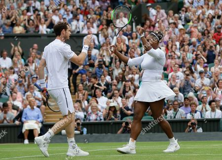 Britain's Andy Murray and United States' Serena Williams celebrate defeating Fabrice Martin of France and Raquel Atawo of the United States in a mixed doubles match on day eight of the Wimbledon Tennis Championships in London