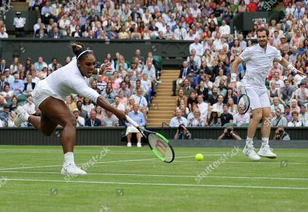 United States' Serena Williams and playing partner Britain's Andy Murray in action against Fabrice Martin of France and Raquel Atawo of the United States in a mixed doubles match on day eight of the Wimbledon Tennis Championships in London