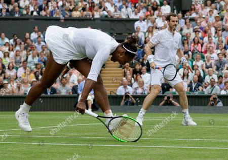 Stock Photo of United States' Serena Williams and playing partner Britain's Andy Murray in action against Fabrice Martin of France and Raquel Atawo of the United States in a mixed doubles match on day eight of the Wimbledon Tennis Championships in London