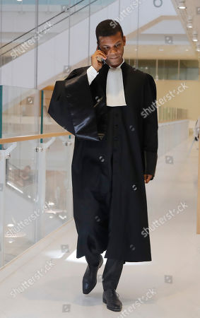 Yassine Bouzrou the Lawyer of the bodyguard of Saudi Princess Hassa bint Salman speaks on his mobile phone at courthouse in Paris, France, . Princess Hassa bint Salman the sister of the Crown Prince Mohammed bin Salman of Saudi Arabia faces a verdict Tuesday in a French trial over the alleged beating of a workman who was refurbishing her ultra-luxury apartment in Paris