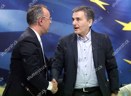 Stock Picture of Newly appointed Finance Minister Christos Staikouras (L) shakes hands with the outgoing Finance Minister Euclid Tsakalotos (R) during a handover ceremony at the Finance Ministry in Athens, Greece, 09 July 2019. The center-right New Democracy party won the general elections in Greece on 07 July and formed a majority government.