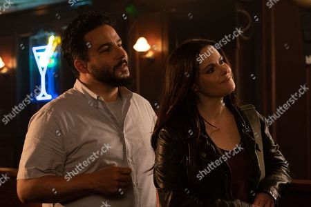 Ennis Esmer as Emir Kaplan and Emily Hampshire as Stevie Budd