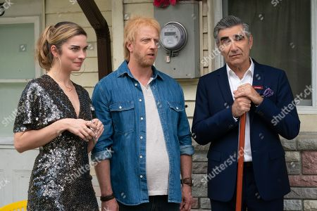Stock Image of Annie Murphy as Alexis Rose, Chris Elliott as Roland Schitt and Eugene Levy as Johnny Rose