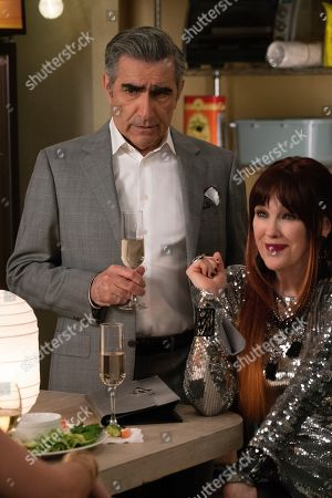 Eugene Levy as Johnny Rose and Catherine O'Hara as Moira Rose