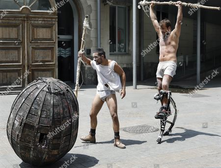 Members of theater company 'La Fure dels Baus' perform during a press preview on occasion of the presentation of the play 'Manes' in Barcelona, Spain, 09 July 2019. 'Manes' celebrates the company's 40th anniversary, staged at the Festival Grec in Barcelona from 17 to 21 July.