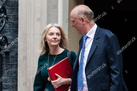 Chief Secretary to the Treasury Liz Truss (L) and Secretary of State for Transport Chris Grayling (R) leave 10 Downing Street in London after the weekly Cabinet meeting.