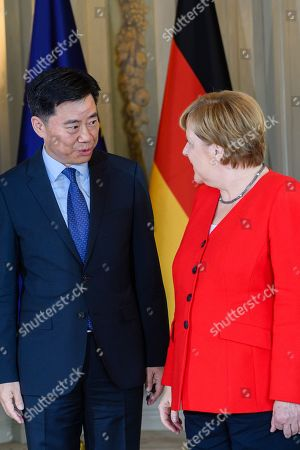 China Ambassador to Germany Wu Ken (L) is welcomed by German Chancellor Angela Merkel (R) during a reception for members of the Diplomatic Corps in the guesthouse of the Federal Government near in Meseberg near Berlin, Germany, 09 July 2019. The traditional annual reception of the Diplomatic Corps takes place annually. Invited to this event are ambassadors of the states accredited in Germany as well as heads of international organizations.