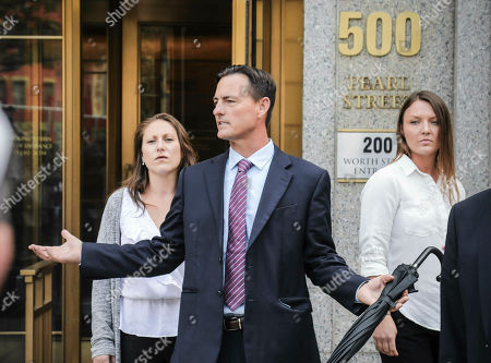 Lawyer Brad Edwards, center, leaves federal court with his clients Michelle Licata, left, and Courtney Wild, right, after wealthy financier Jeffrey Epstein appeared for his arraignment in New York. Licata and Wild, two of Epstein's accusers, say they feel empowered after he was charged with sex trafficking and conspiracy charges. Epstein pleaded not guilty to the charges and will remain jailed until at least July 15 when a bail hearing is set on the case