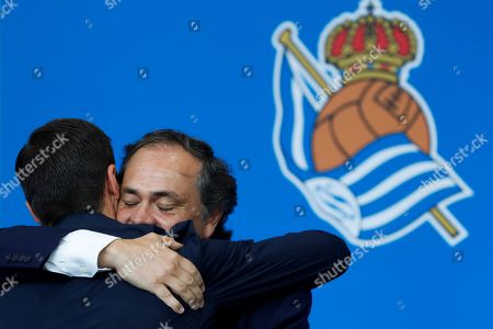 Spanish former player Xabi Alonso (L) hugs Real Sociedad's president Jokin Aperribay (R) during his presentation as head coach of Sanse soccer team at Zubieta facilities, in Lasarte, Basque Country, Spain, 09 July 2019. Former Real Sociedad, Liverpool and Real Madrid midfielder Xabi Alonso has signed as the new head coach of Real Sociedad's B team (Sanse).
