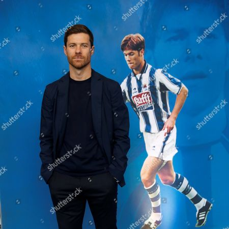 Spanish former player Xabi Alonso (C) poses for the media during his presentation as head coach of Sanse soccer team at Zubieta facilities, in Lasarte, Basque Country, Spain, 09 July 2019. Former Real Sociedad, Liverpool and Real Madrid midfielder Xabi Alonso has signed as the new head coach of Real Sociedad's B team (Sanse).