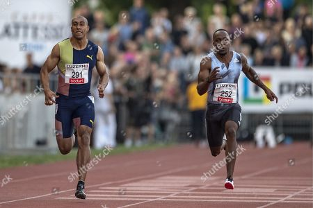 Akani Simbine, right, from South Africa and Asafa Powell, left, from Jamaica during the Men 100m race at the International Athletics Meeting in Lucerne, Switzerland, Tuesday, July 9, 2019.