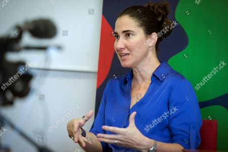 Stock Picture of Cuban journalist and dissident Yoani Sanchez speaks during an interview with Spanish international news agency Efe in Madrid, Spain, 09 July 2019.